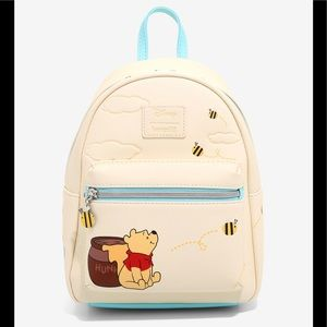 Loungefly WinnieThePooh Character Clouds backpack
